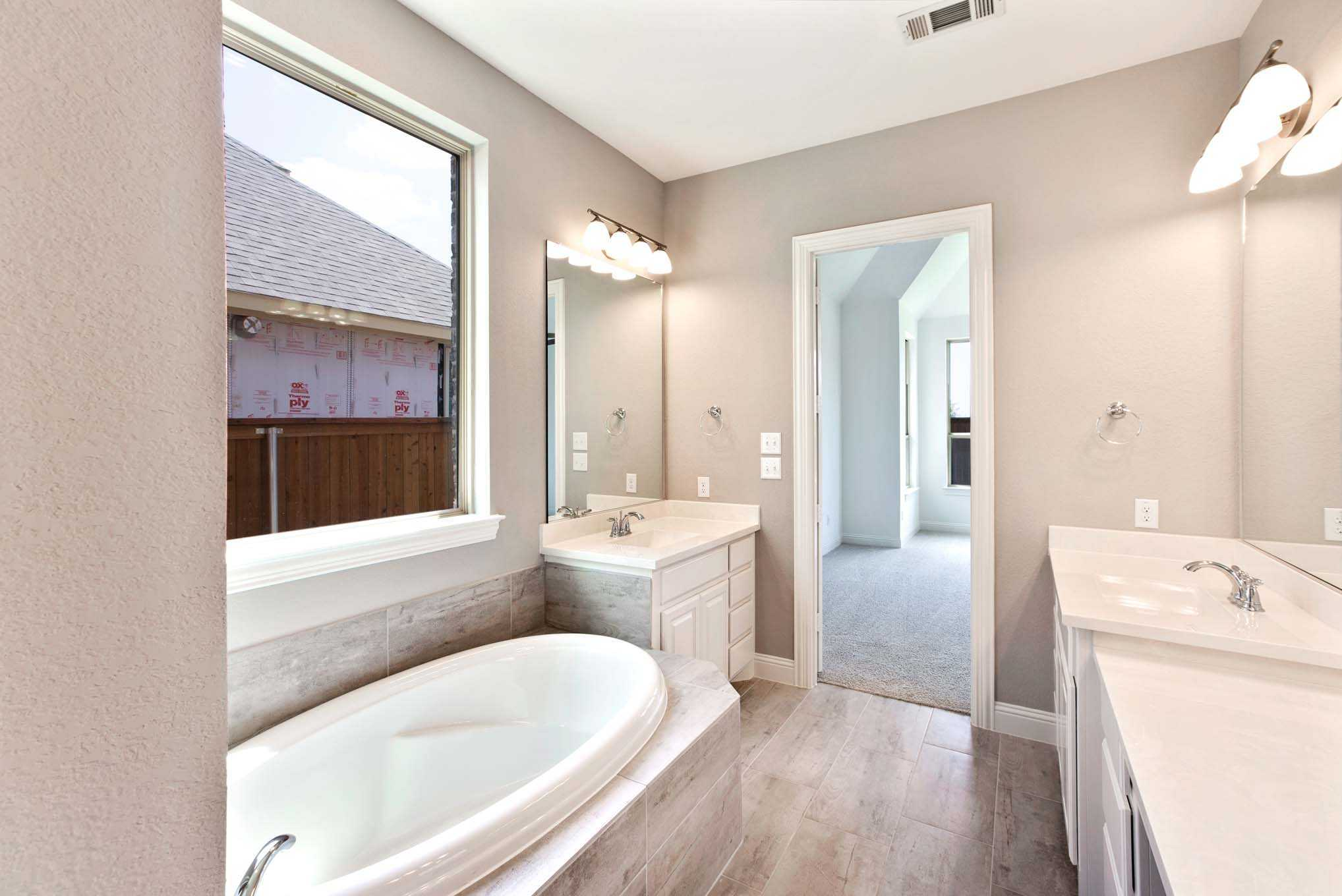 Bathroom featured in the Plan 221 By Highland Homes in Dallas, TX