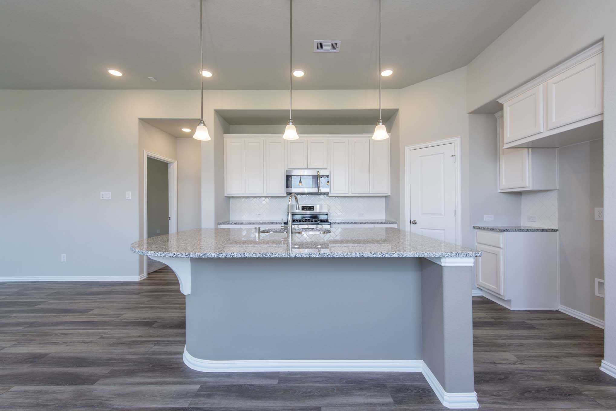 Kitchen featured in the Plan Windsor By Highland Homes in Houston, TX