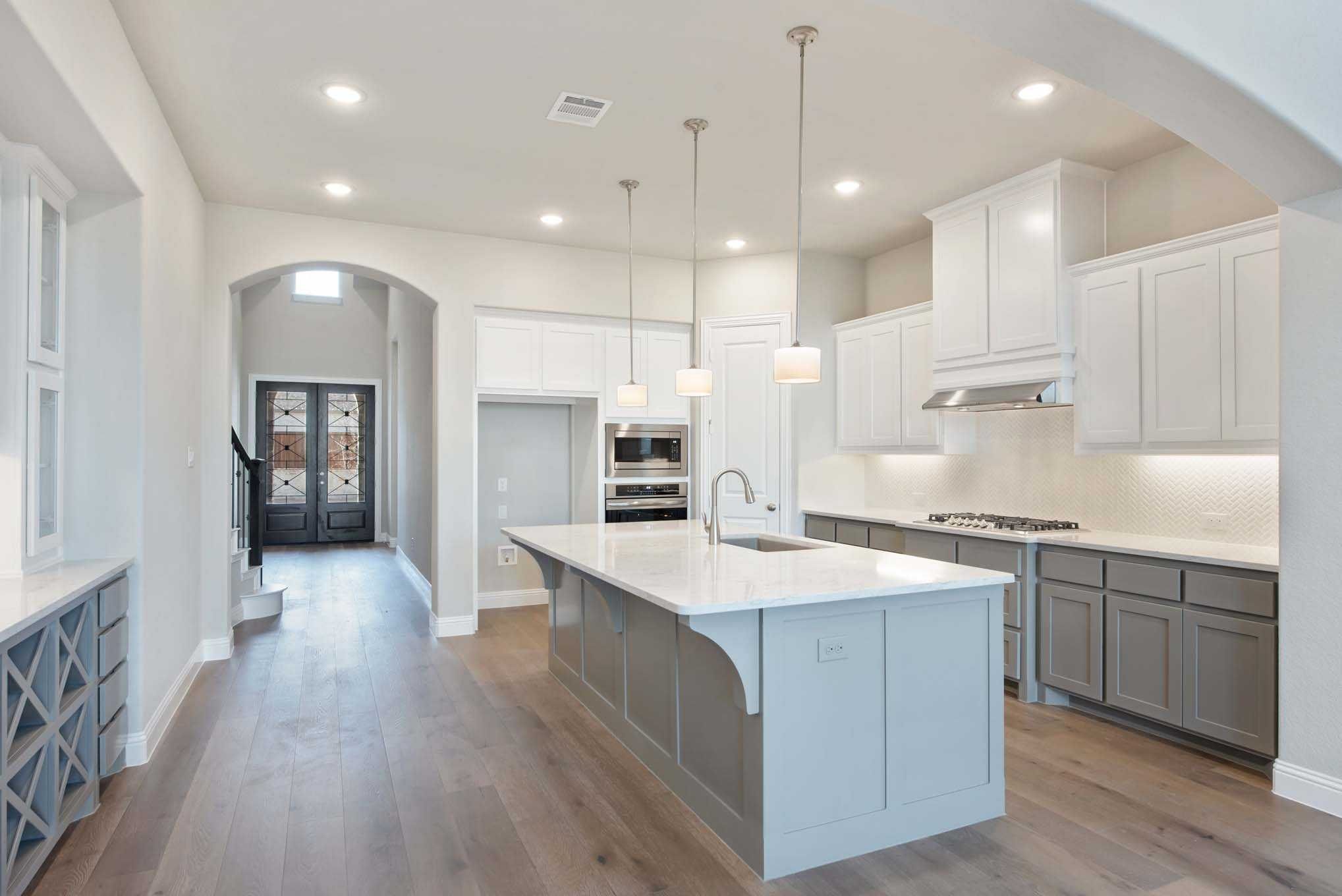 Kitchen featured in the Plan 224 By Highland Homes in Austin, TX
