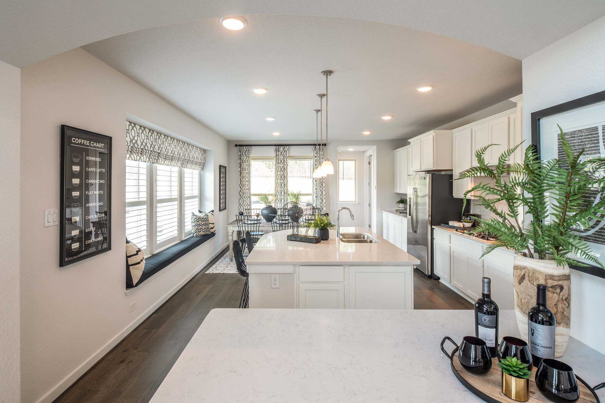 Kitchen featured in the Plan Everleigh By Highland Homes in Houston, TX