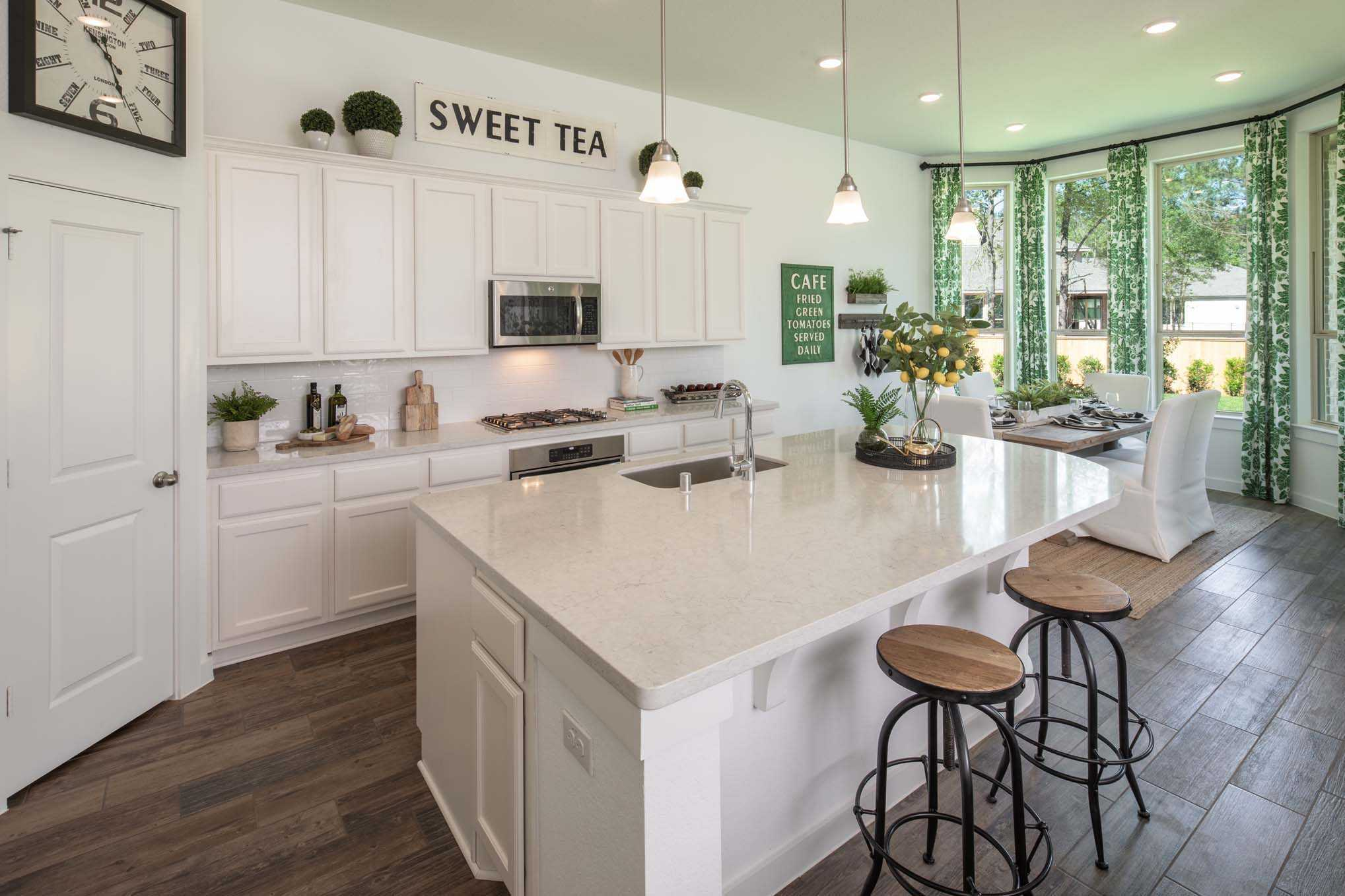 Kitchen featured in the Plan Amberley By Highland Homes in Austin, TX