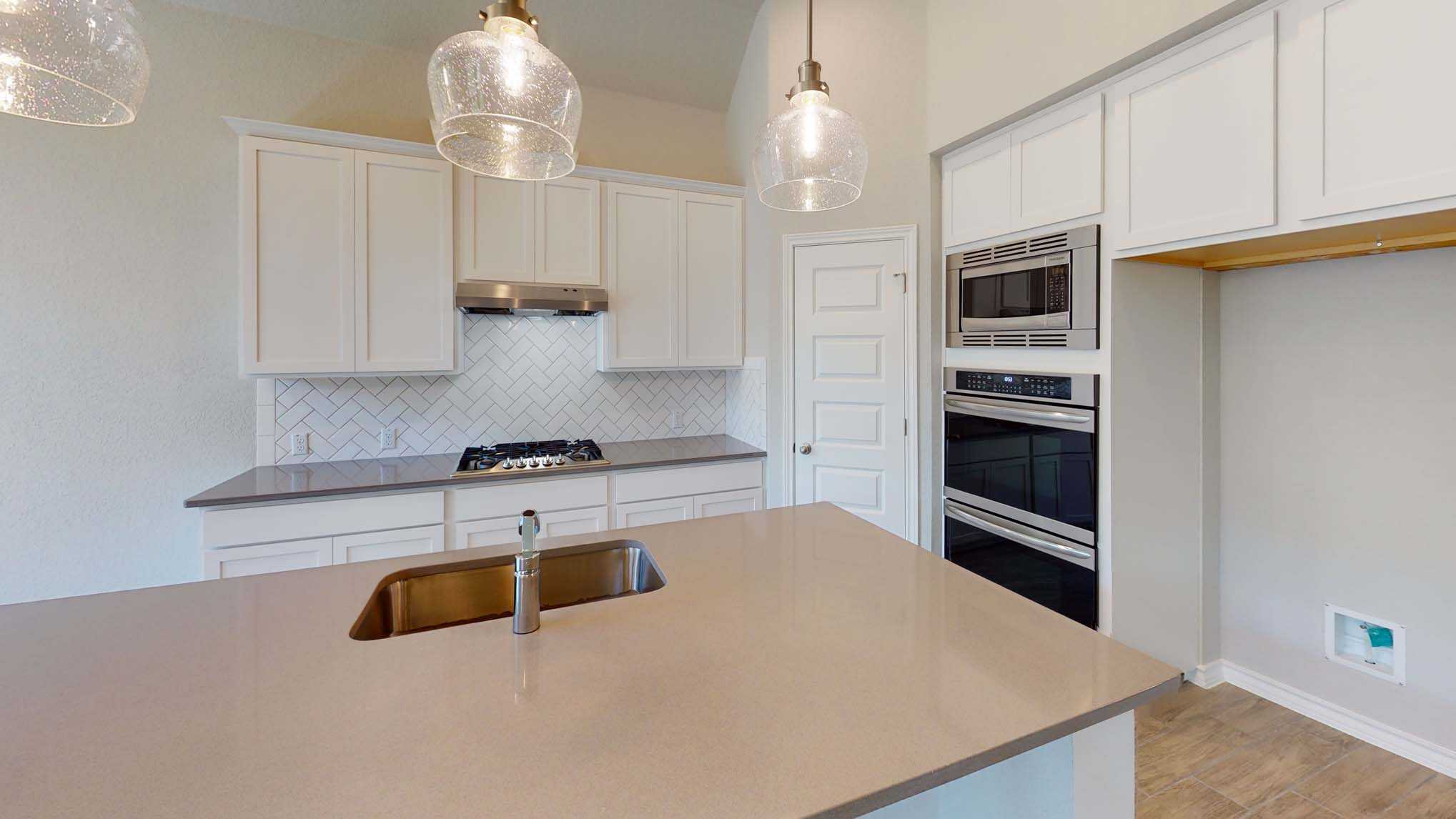 Kitchen featured in the Plan Dorchester By Highland Homes in San Antonio, TX