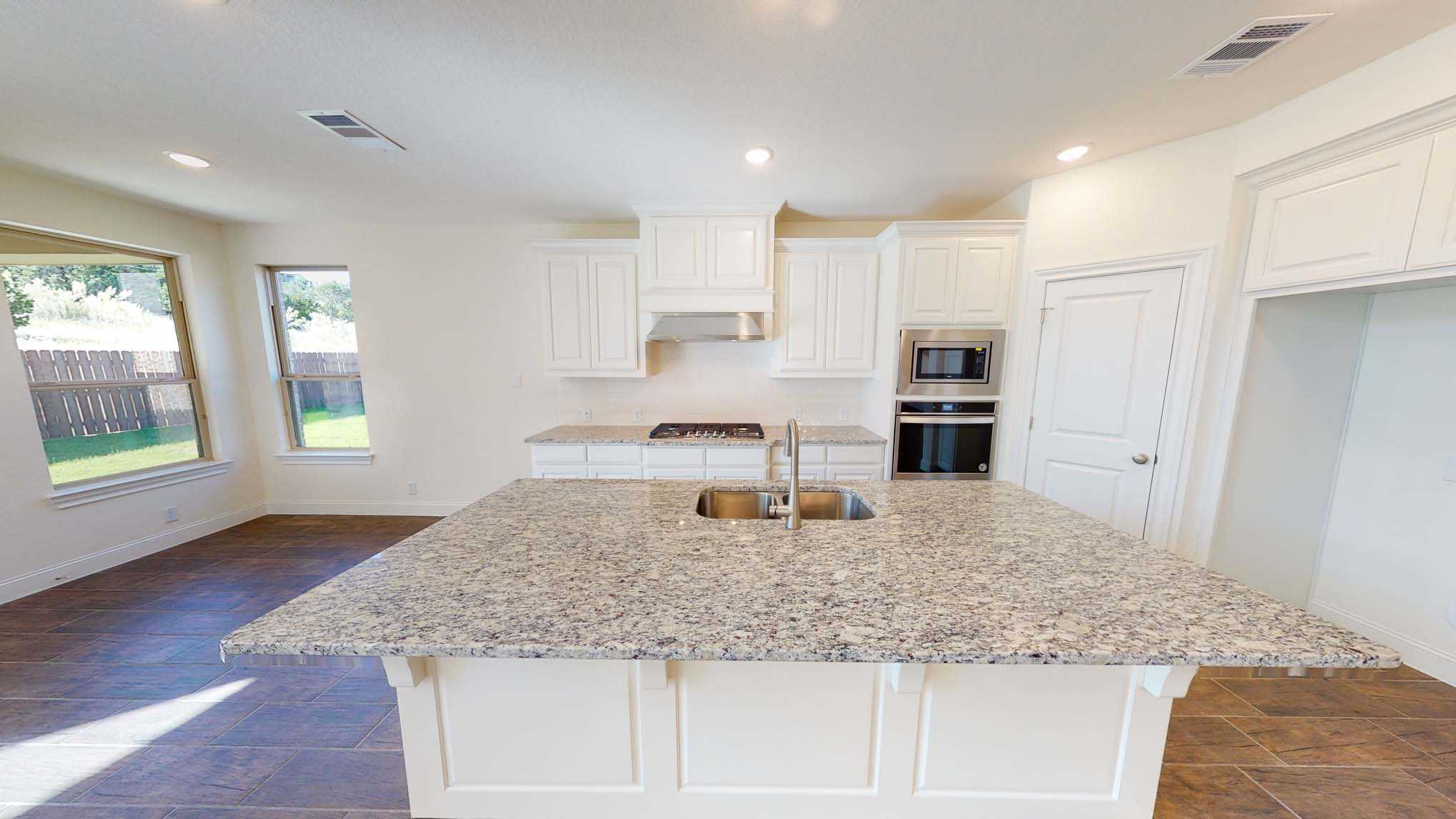 Kitchen featured in the Plan 559H By Highland Homes in San Antonio, TX