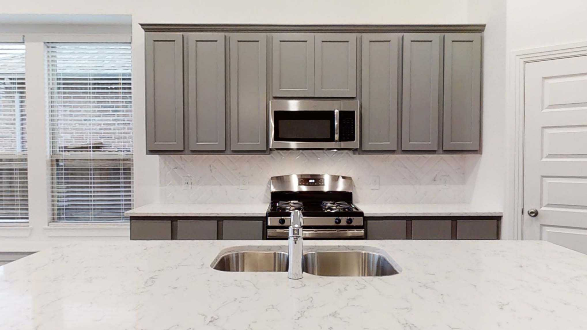 Kitchen featured in the Plan Denton By Highland Homes in Dallas, TX
