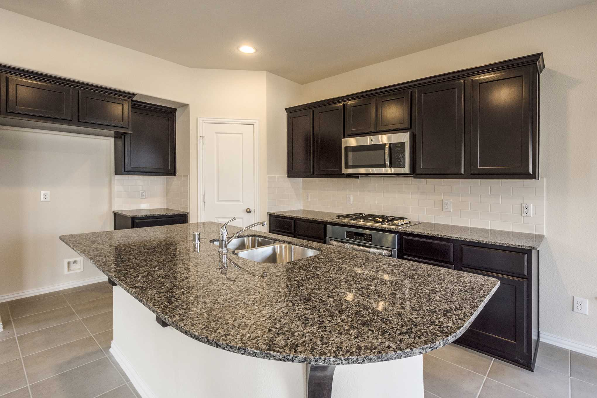 Kitchen featured in the Plan Cotswold By Highland Homes in San Antonio, TX