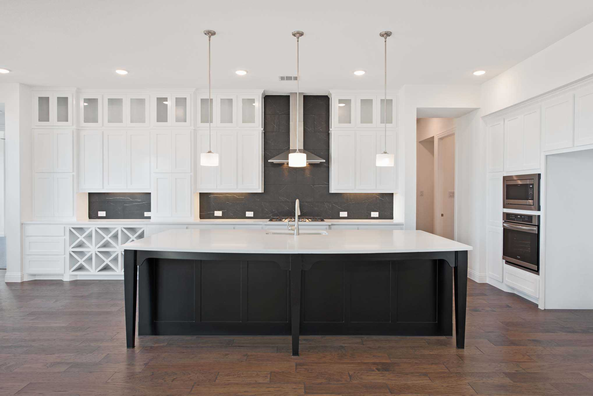 Kitchen featured in the Plan 220 By Highland Homes in San Antonio, TX