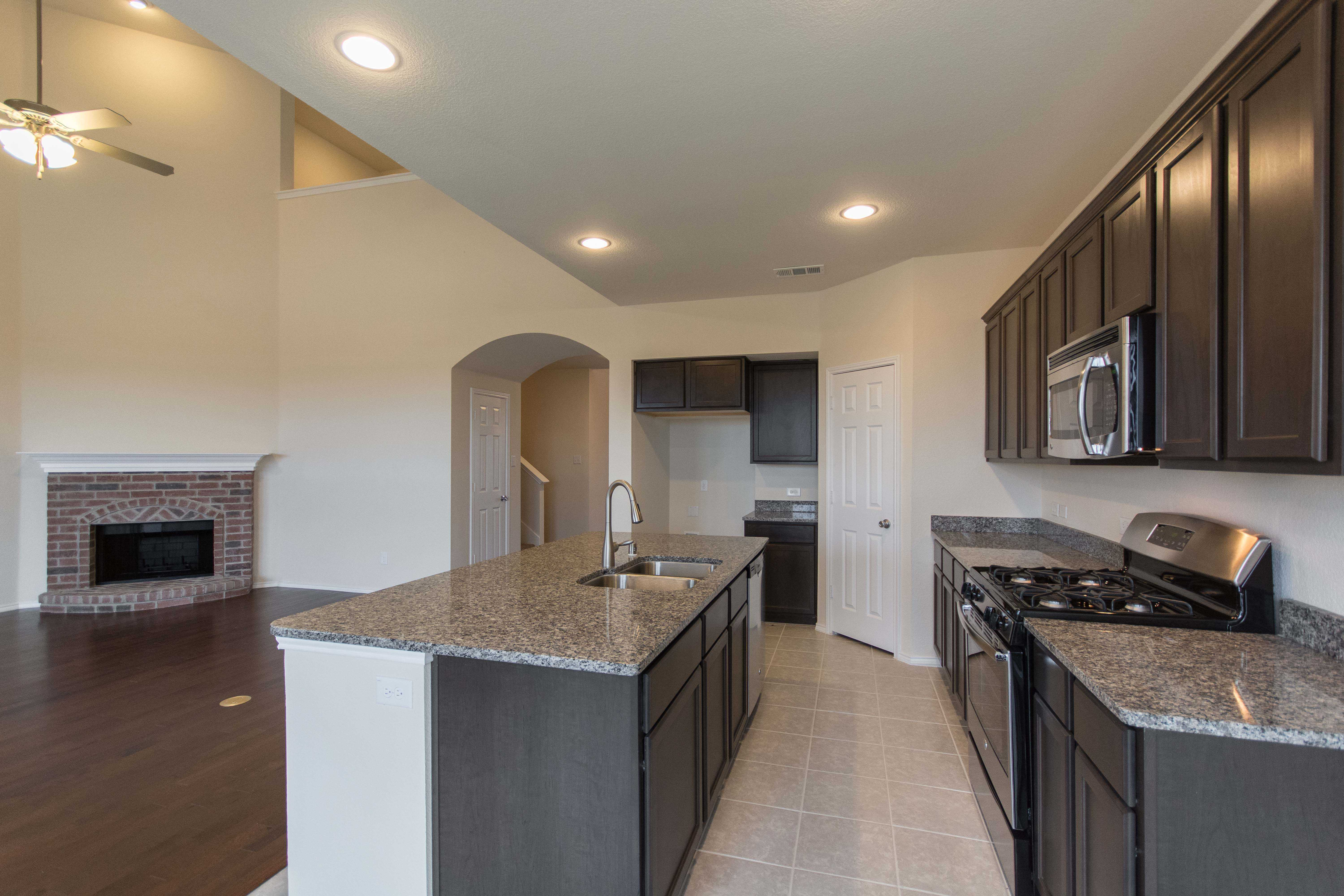 Kitchen featured in the Plan Eastbourne By Highland Homes in Dallas, TX