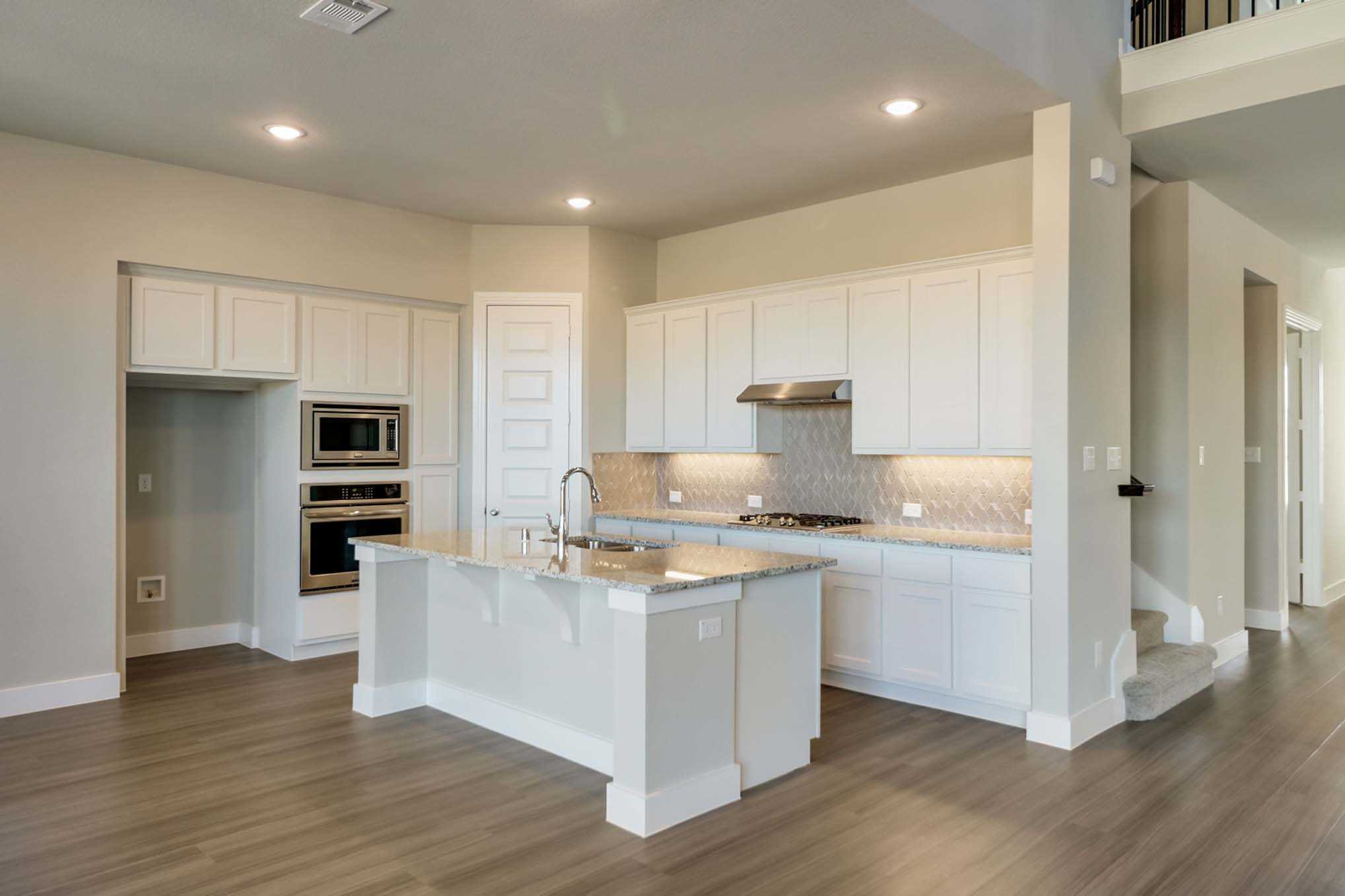 Kitchen featured in the Plan Wimbledon By Highland Homes in Dallas, TX