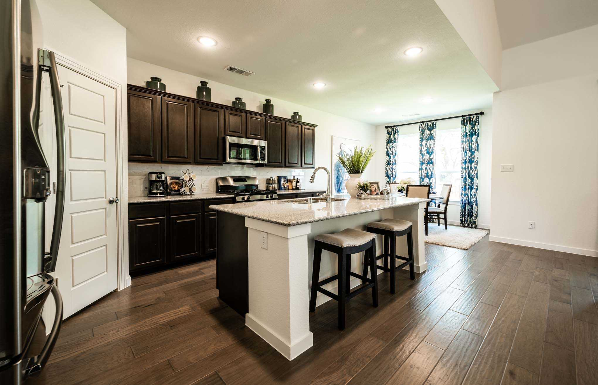 Kitchen featured in the Plan Yorkshire By Highland Homes in Dallas, TX