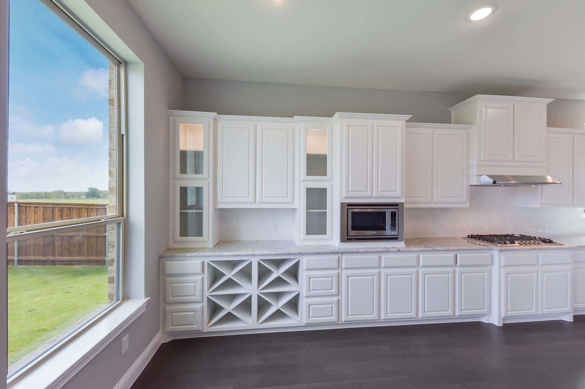 Kitchen featured in the Plan 277 By Highland Homes in Dallas, TX