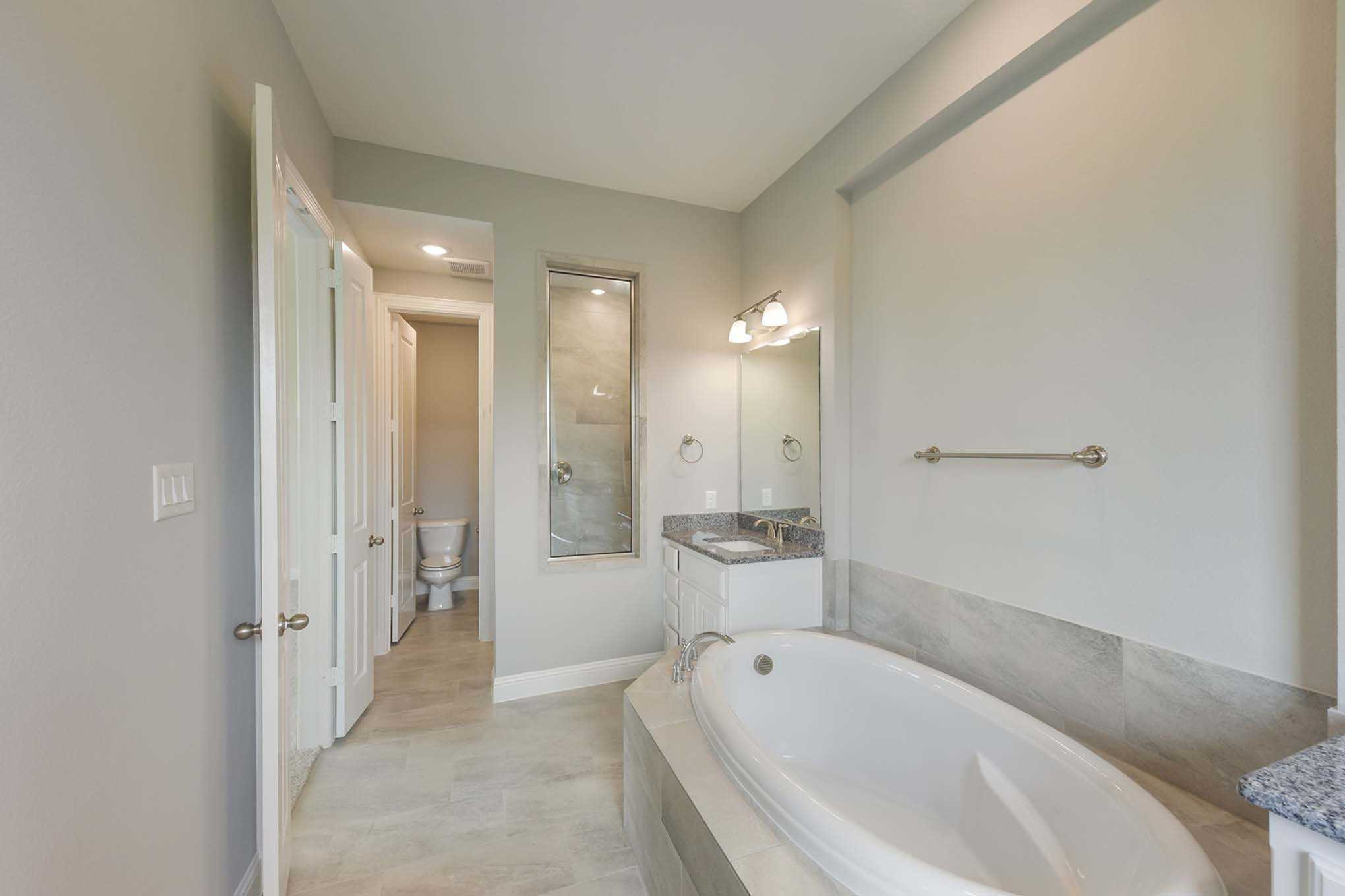 Bathroom featured in the Plan 277 By Highland Homes in Dallas, TX