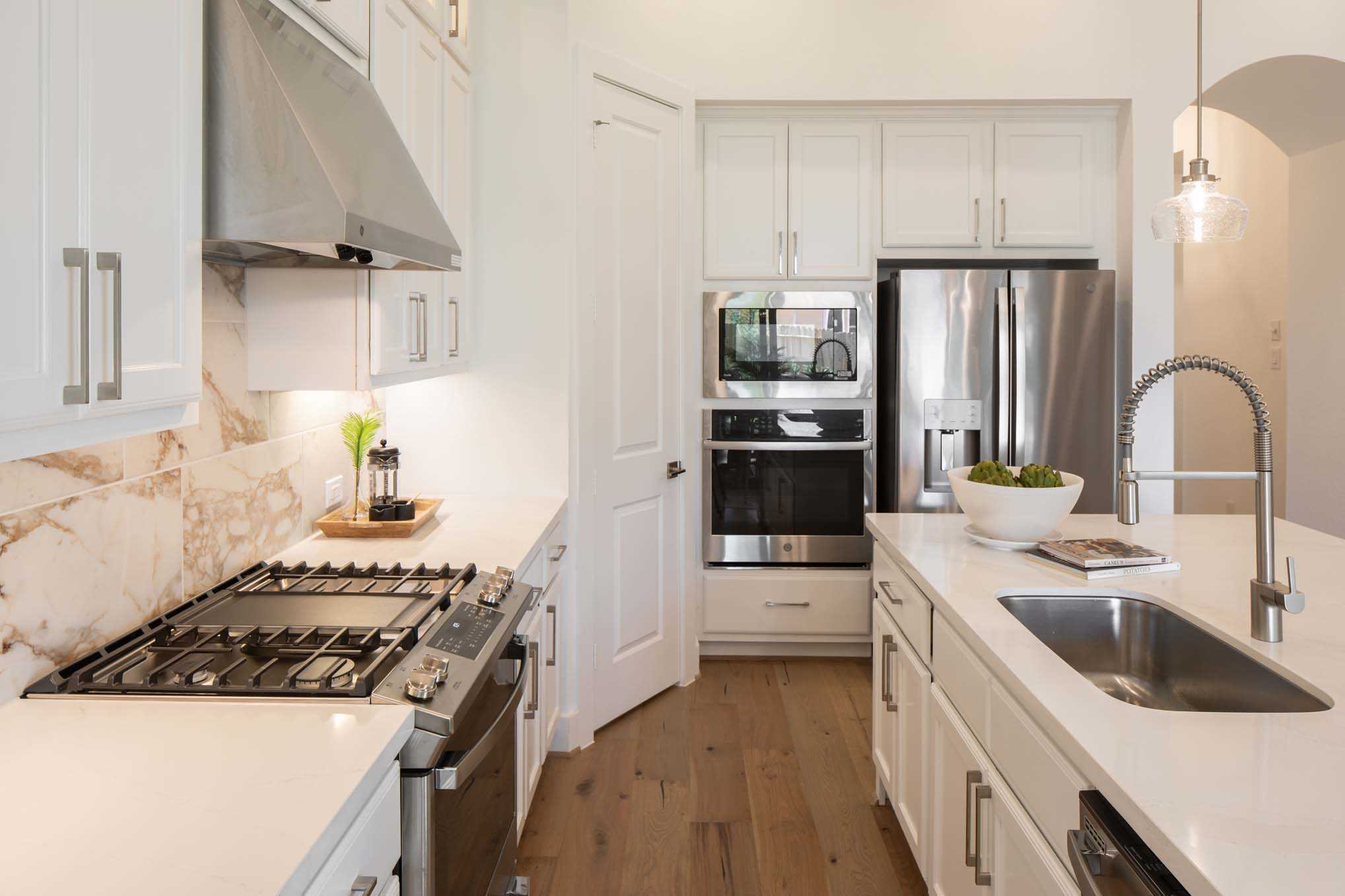 Kitchen featured in the Plan Newport By Highland Homes in Houston, TX