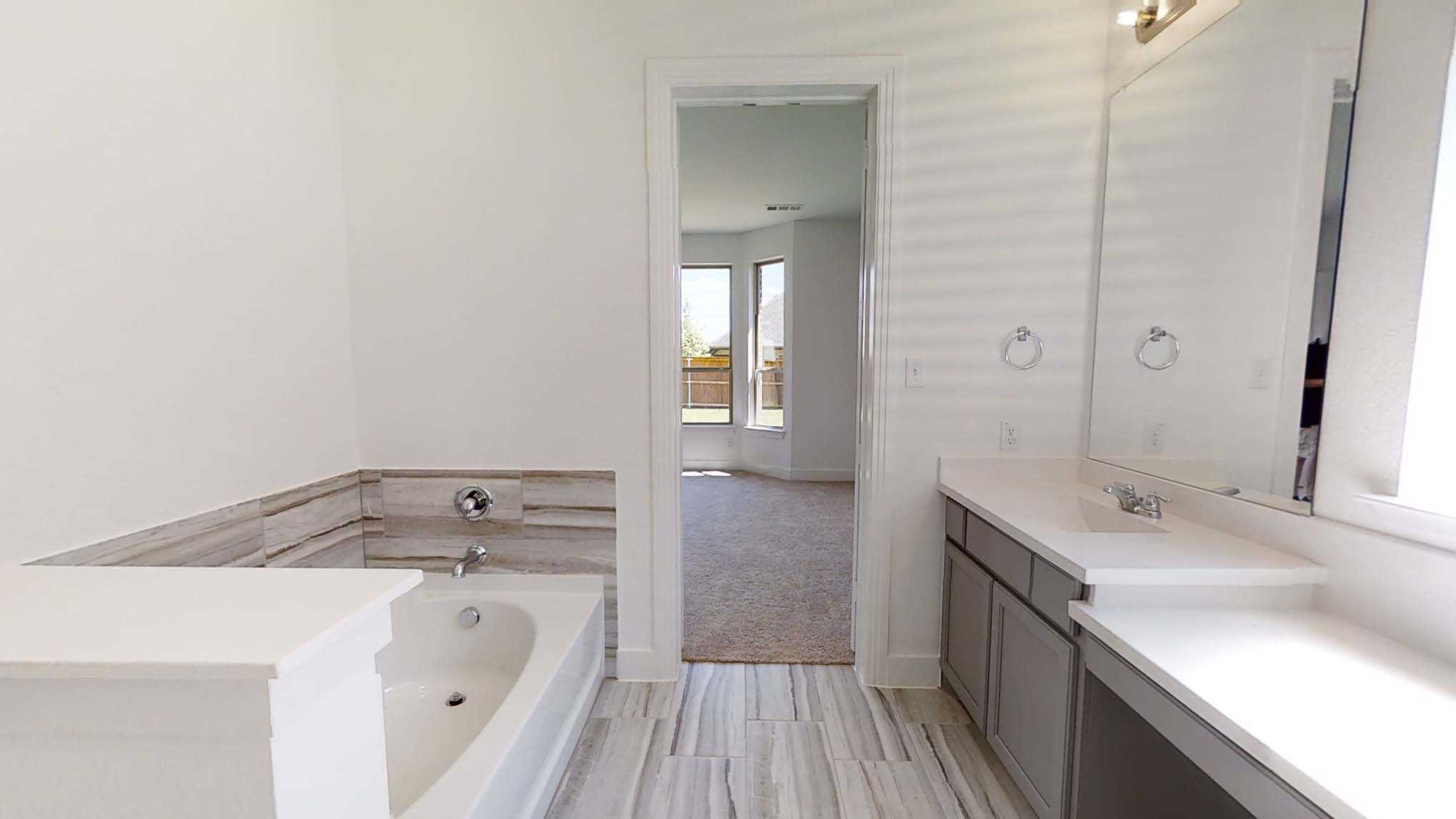 Bathroom featured in the Plan Blenheim By Highland Homes in Dallas, TX