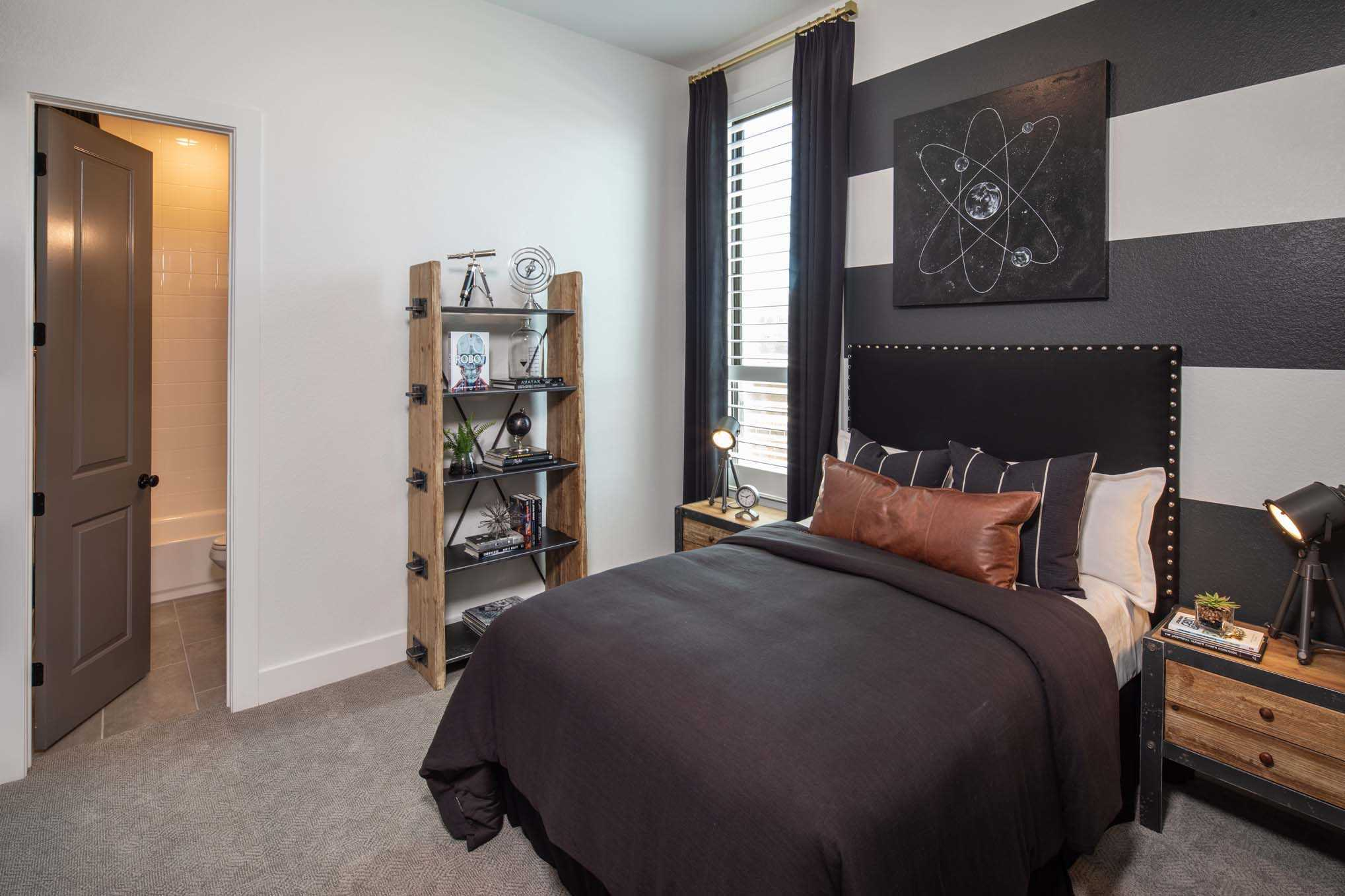 Bedroom featured in the Plan 216 By Huntington Homes in Houston, TX