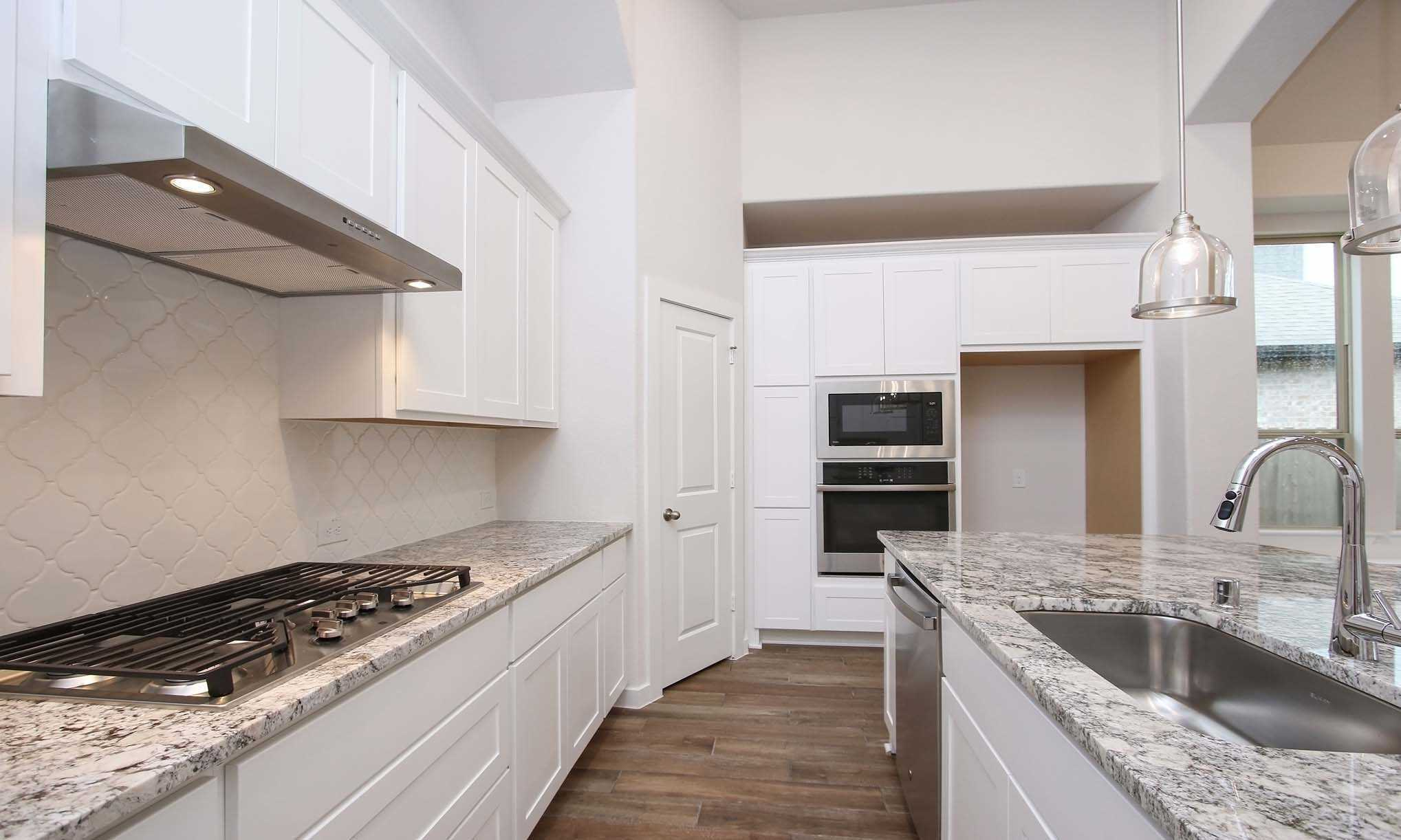 Kitchen featured in the Plan 540 By Highland Homes in Houston, TX