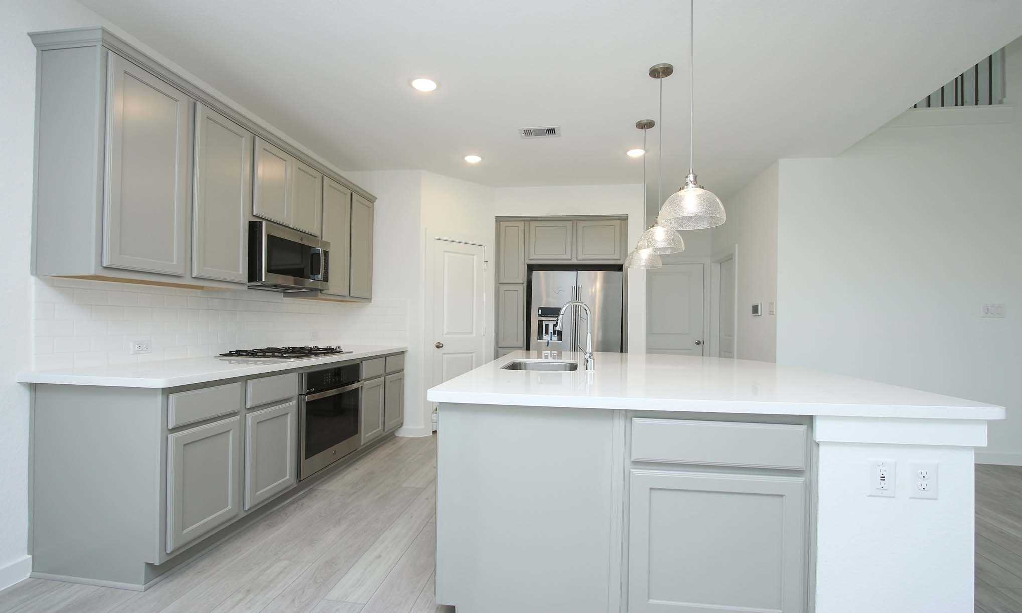 Kitchen featured in the Plan Lyndhurst By Highland Homes in Sherman-Denison, TX