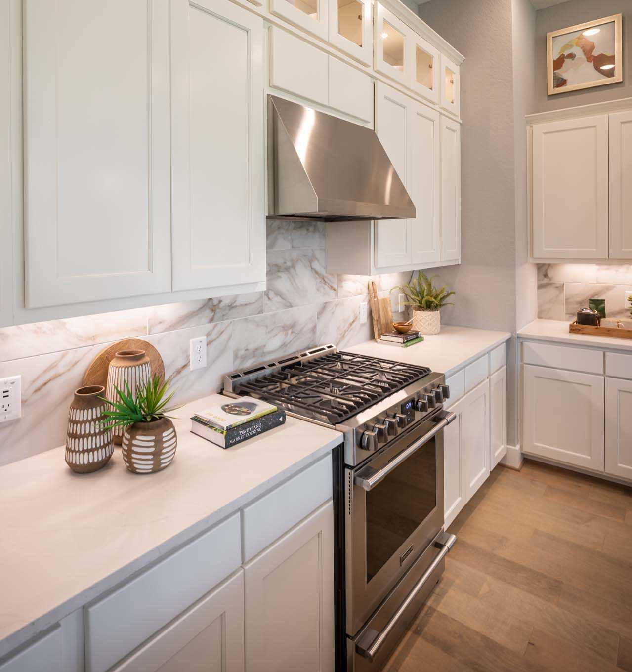 Kitchen featured in the Plan Davenport By Highland Homes in Austin, TX