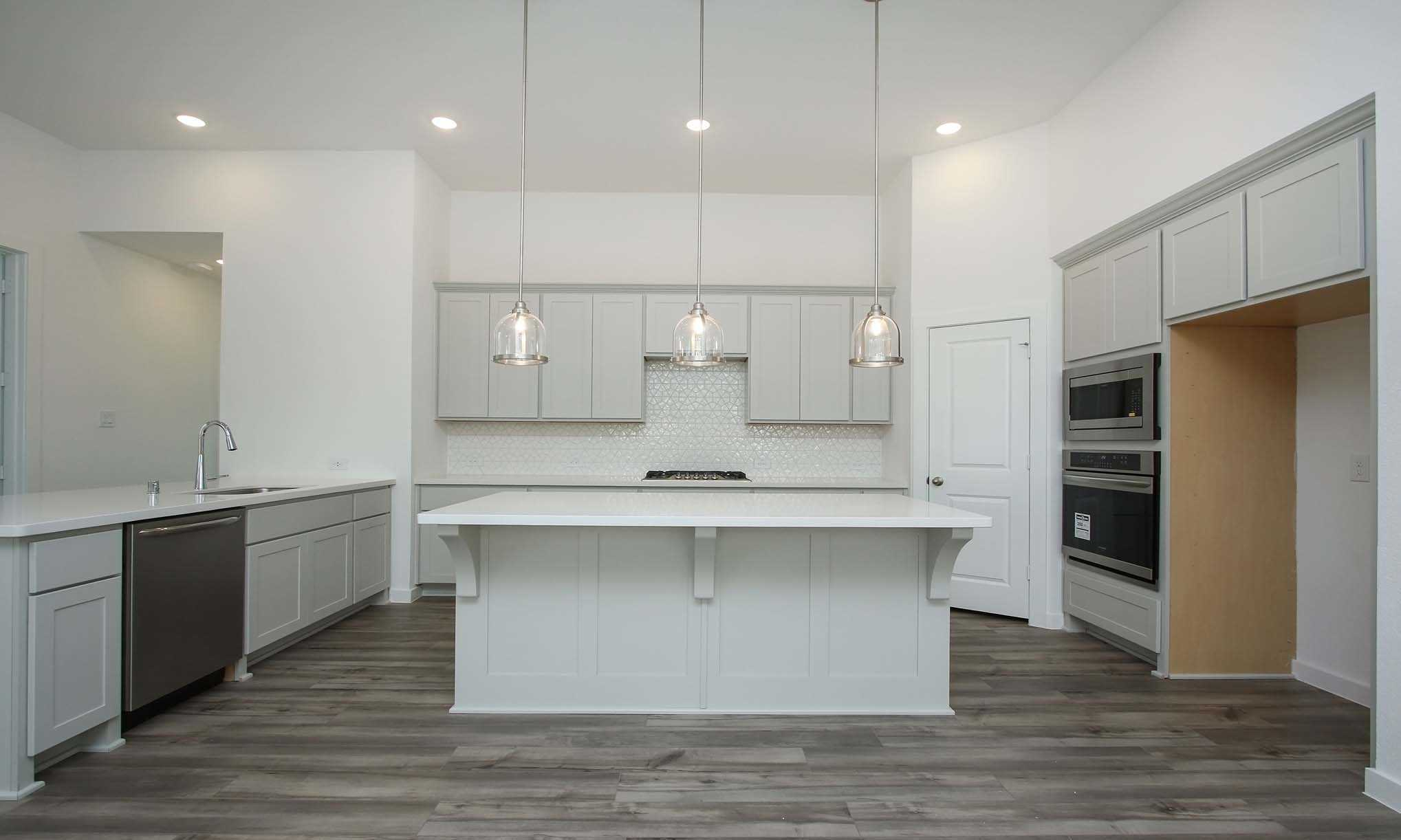 Kitchen featured in the Plan Oxford By Highland Homes in Houston, TX