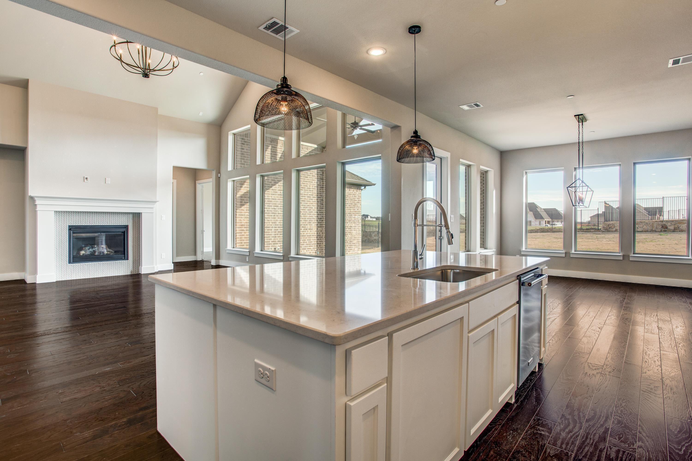 Kitchen featured in The Fredericksburg By Brockdale in Dallas, TX