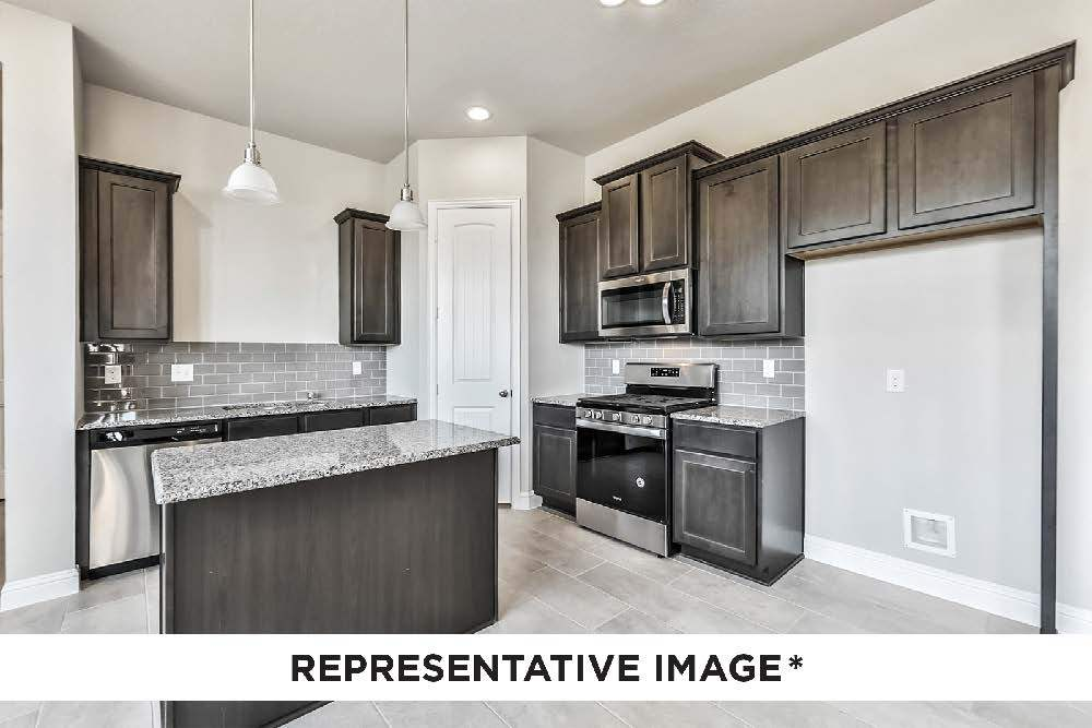 Kitchen featured in the Caddo By HistoryMaker Homes    in Houston, TX