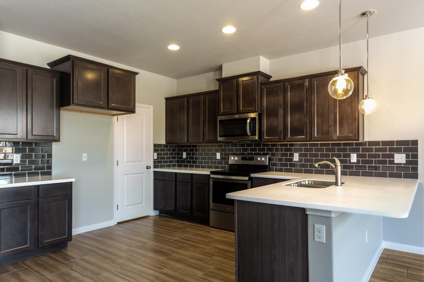 Kitchen featured in the Ridley By Hogan Homes in Corpus Christi, TX