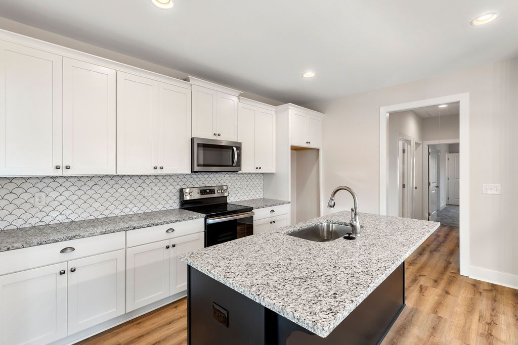 Kitchen featured in the Duette 2 By Holland Homes in Auburn-Opelika, AL