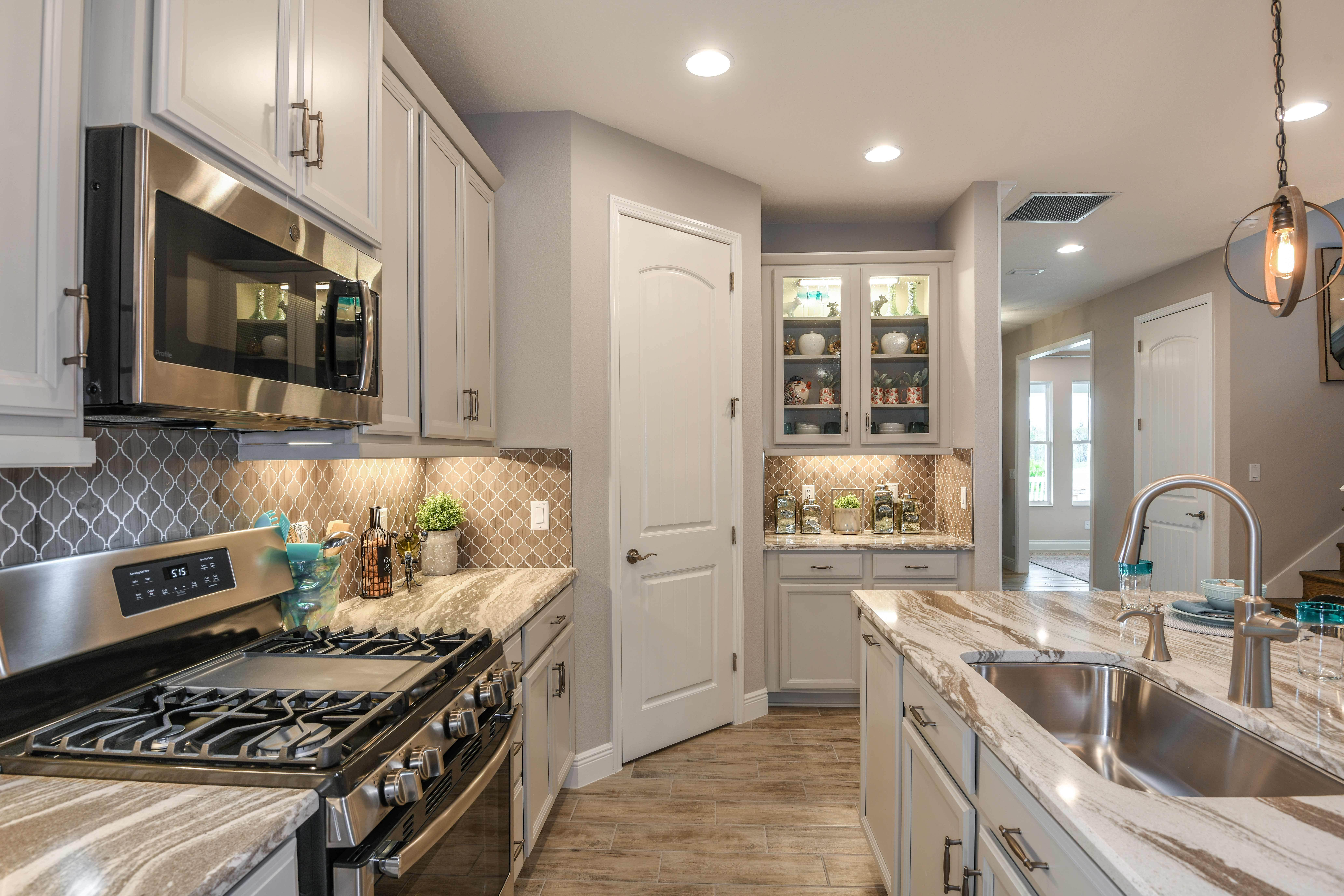 Kitchen featured in the Avocet II By Homes by WestBay in Tampa-St. Petersburg, FL