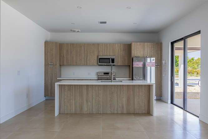 Kitchen featured in the Veneto By Coral Rock Village in Miami-Dade County, FL