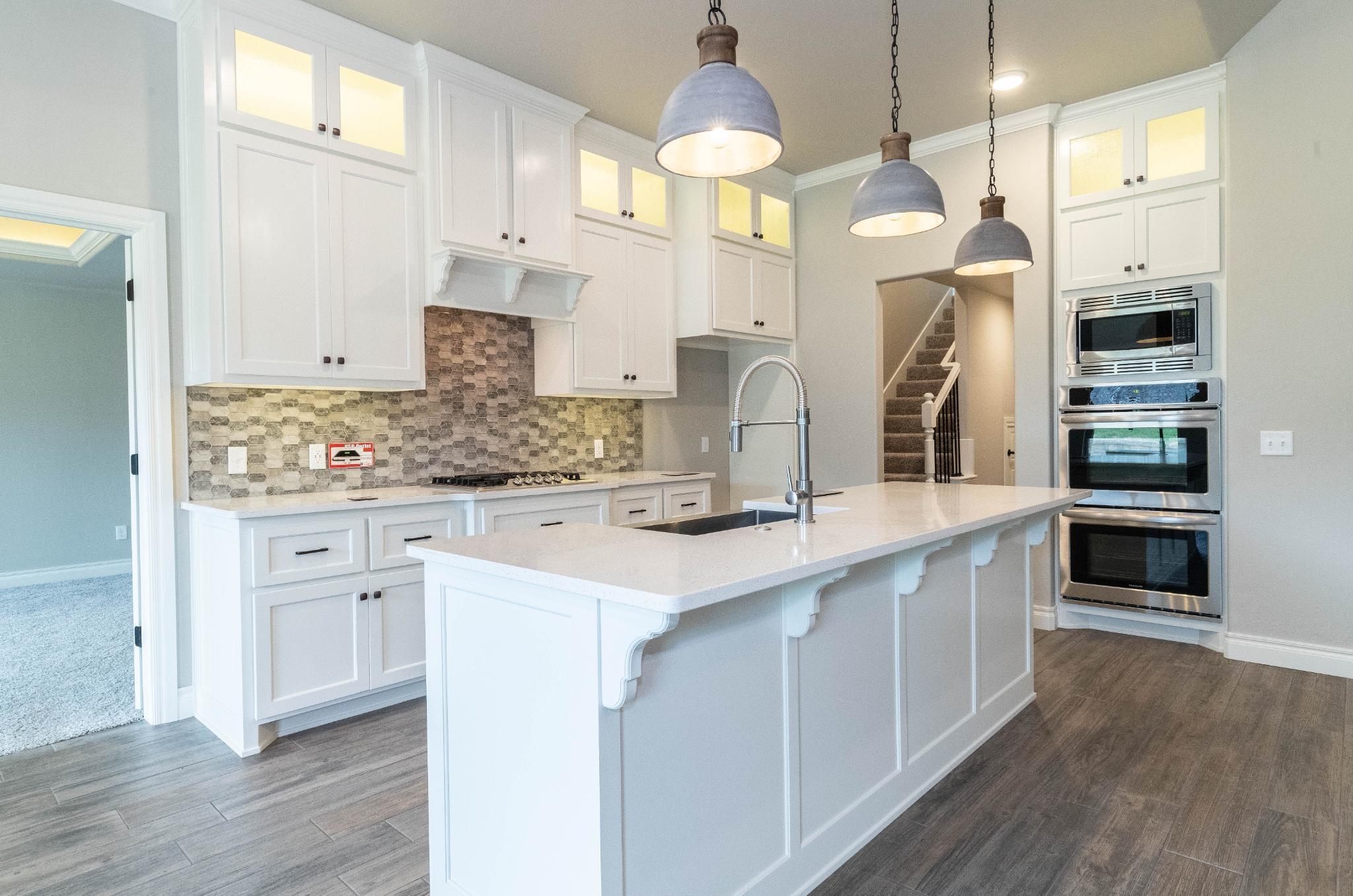 Kitchen featured in the Blue Spruce Bonus Room 1 Plus By Homes By Taber in Oklahoma City, OK
