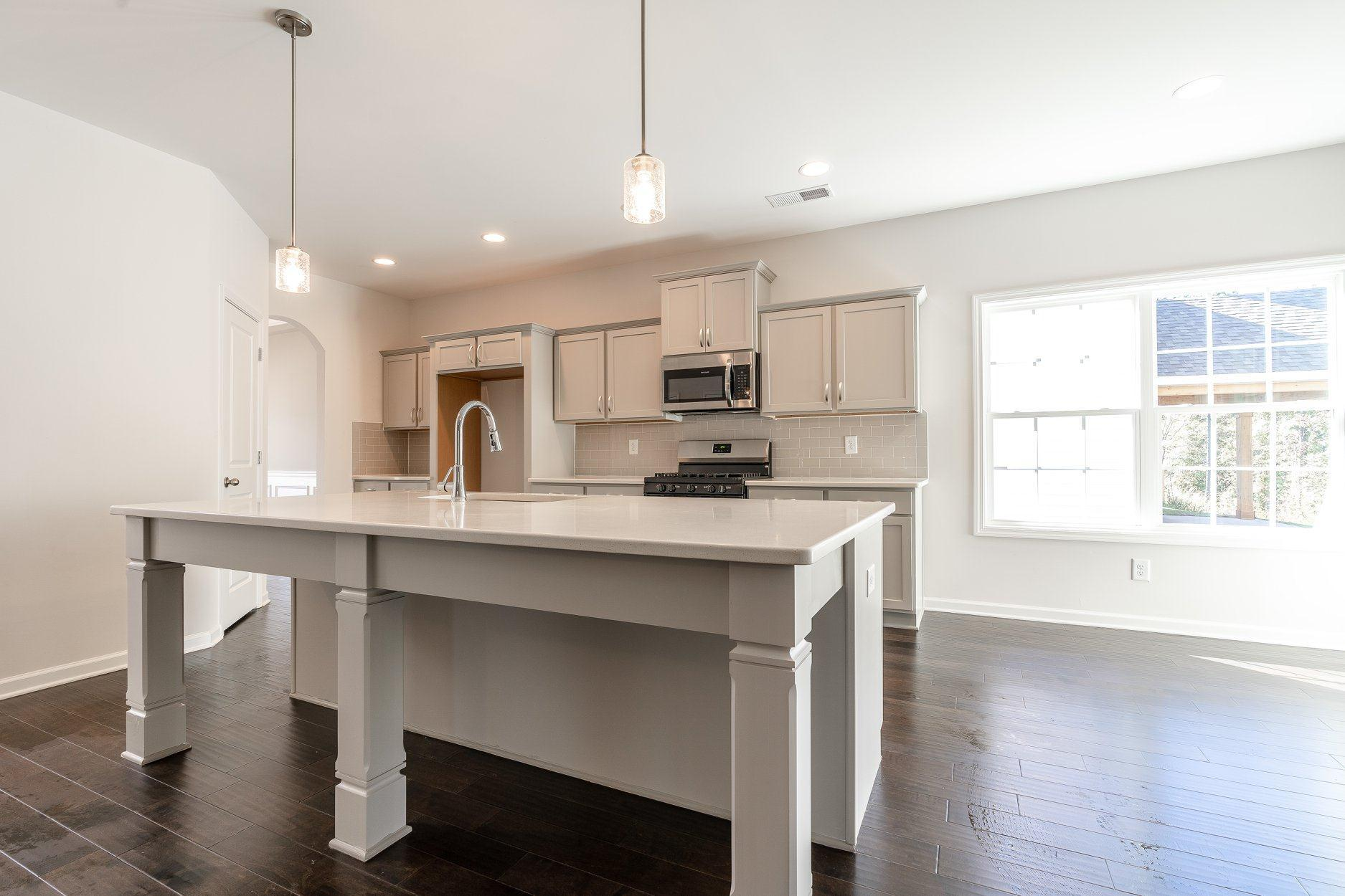 Kitchen featured in the Belmont By Hughston Homes in Macon, GA