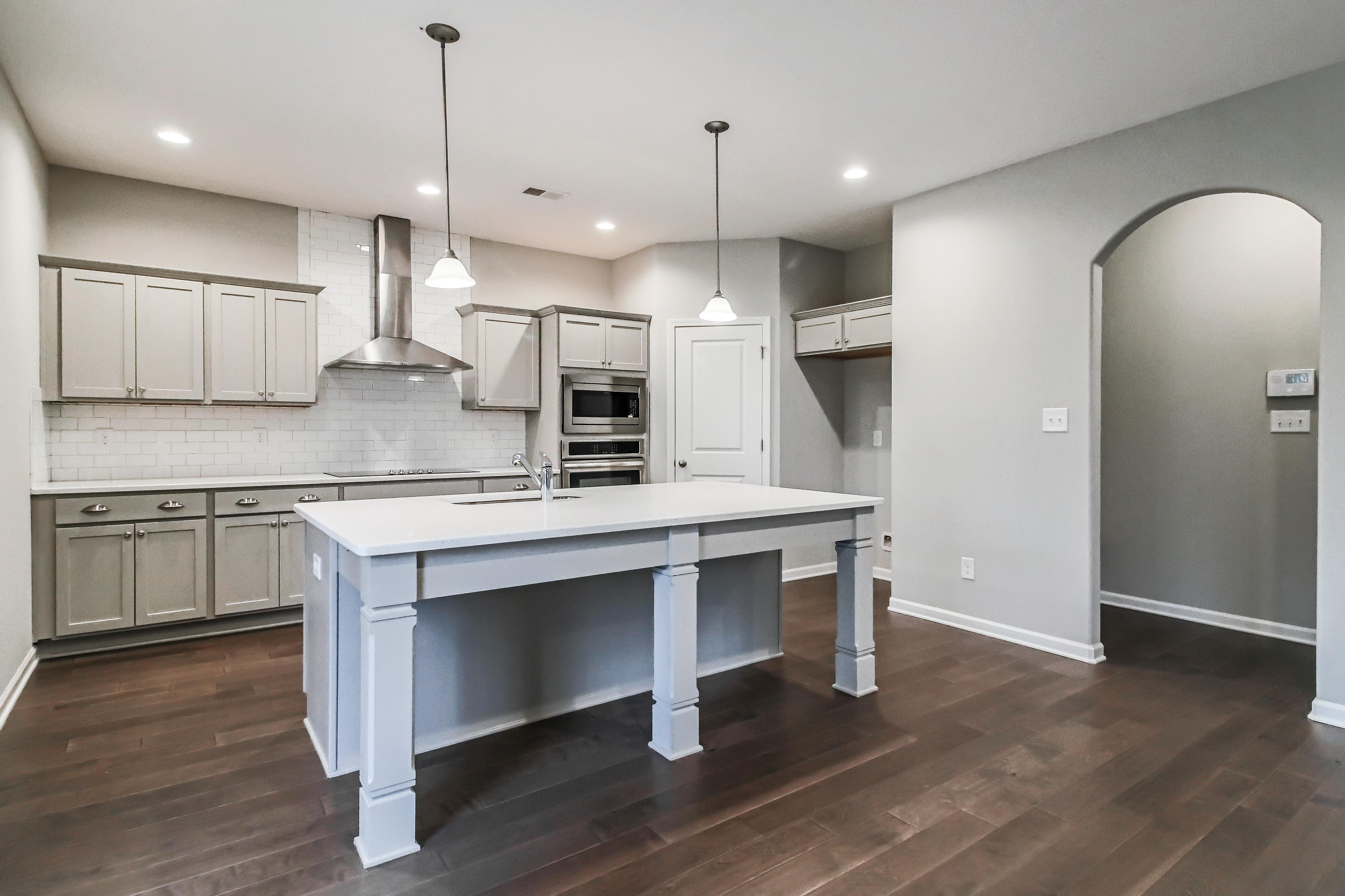 Kitchen featured in the Cypress By Hughston Homes in Macon, GA