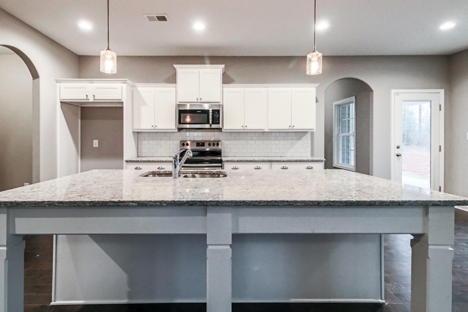 Kitchen featured in the Magnolia By Hughston Homes in Macon, GA