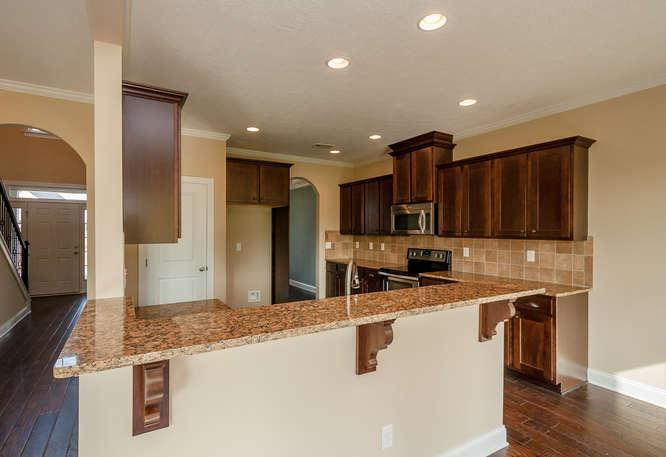Kitchen featured in the Dublin By Ivey Residential in Augusta, GA