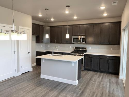 Kitchen-in-The Poplar-at-Sage Meadows at Wolf Ranch-in-Colorado Springs