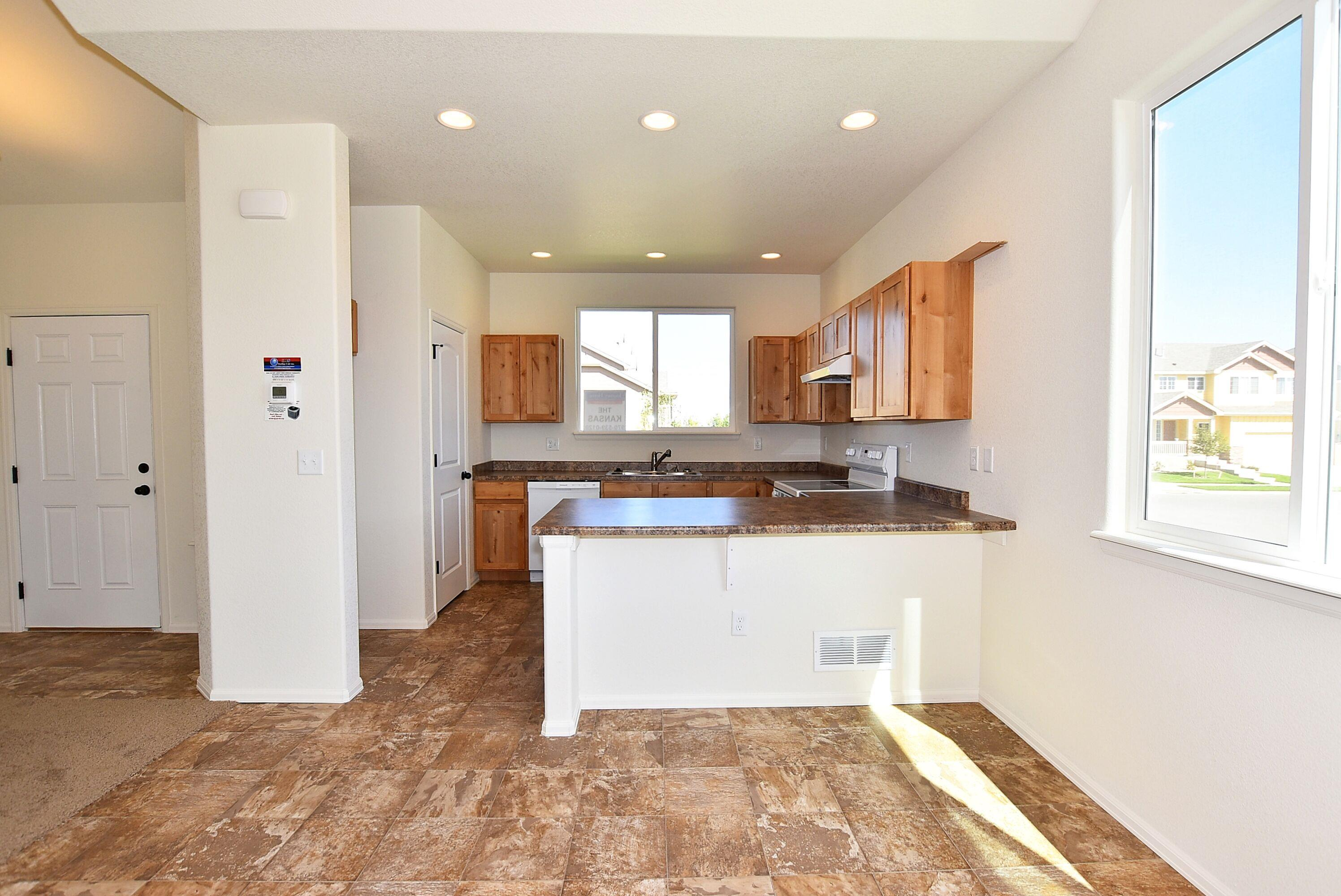 Kitchen featured in the Kansas By Journey Homes in Greeley, CO