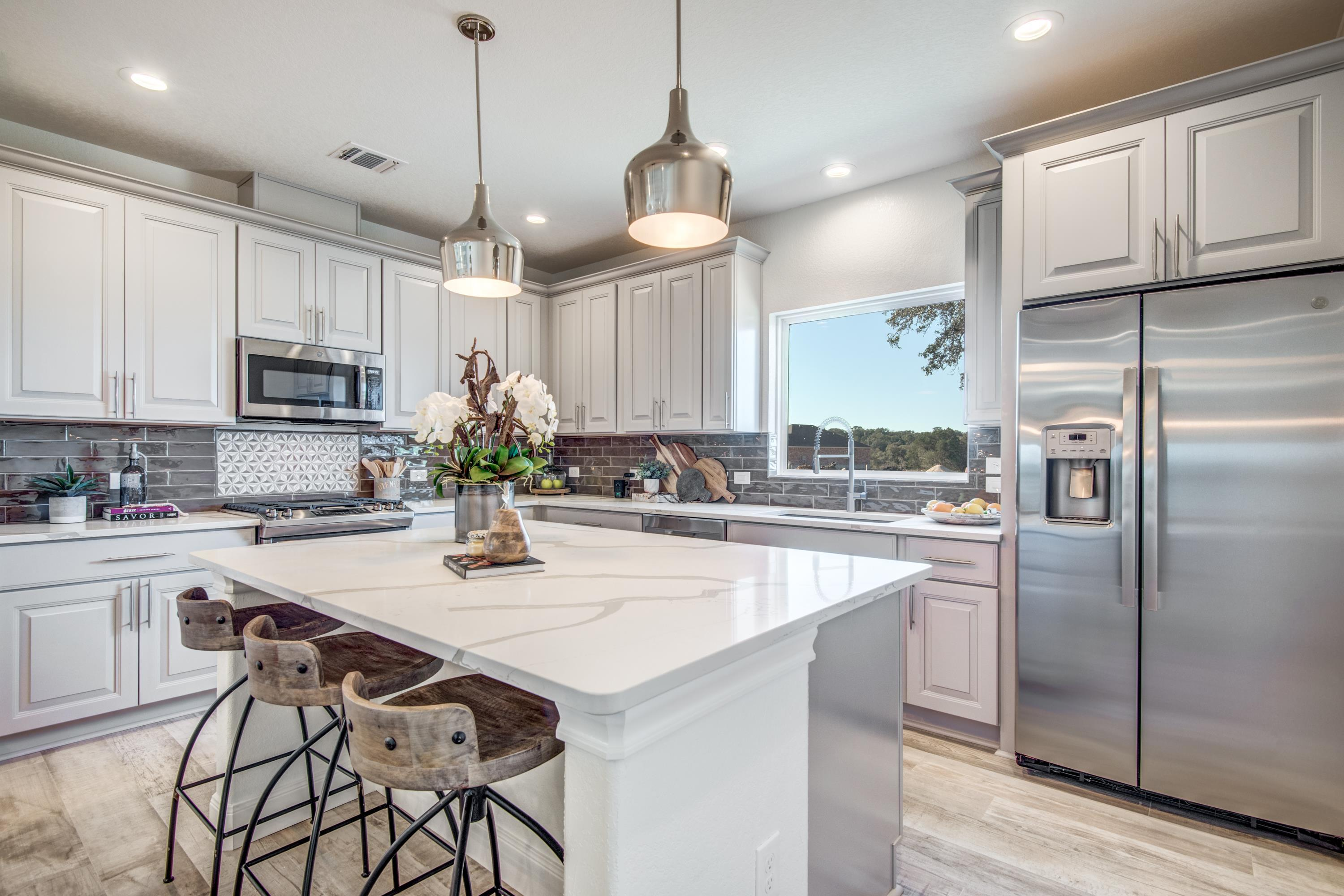 Kitchen featured in The Beaufort II By JuEll Homes in San Antonio, TX