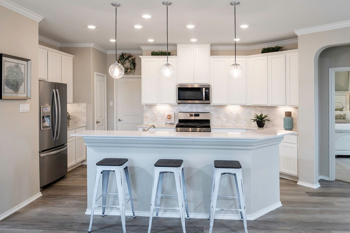 Kitchen-in-Plan E-2412 Modeled-at-Villas at Star Ranch-in-Hutto