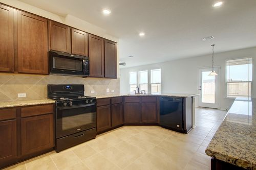 Kitchen-in-Plan F-1771-at-Villas at Star Ranch-in-Hutto