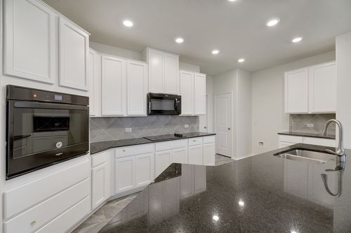 Kitchen-in-Plan E-2412-at-La Conterra - Heritage Collection-in-Georgetown