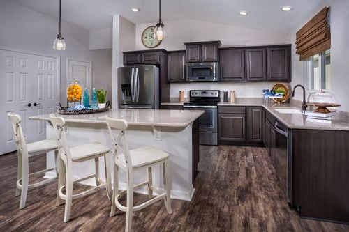 Kitchen-in-The Avondale Modeled-at-Cypress Landings-in-West Melbourne