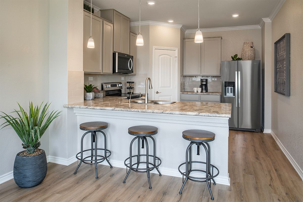 Kitchen featured in the Plan 1780 By KB Home in San Antonio, TX