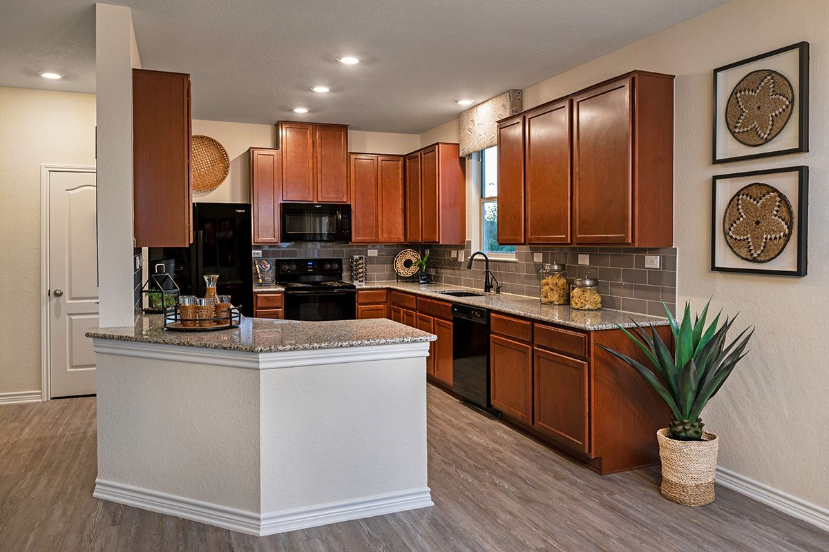 Kitchen featured in the Plan 1909 By KB Home in San Antonio, TX