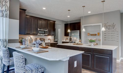 Kitchen-in-Tomasen-at-Herrington Place-in-Reminderville