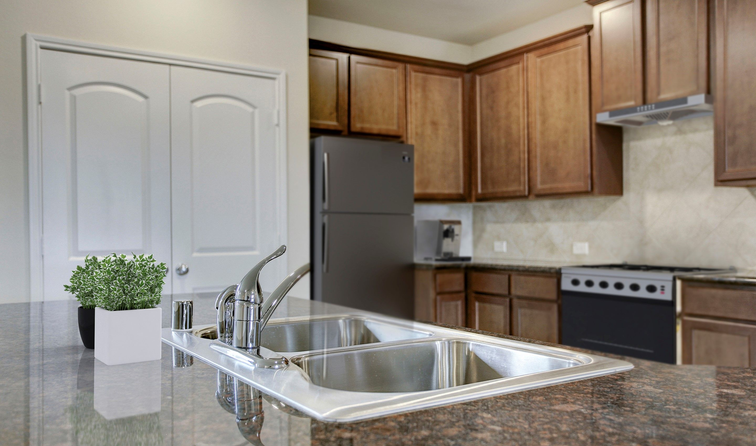 Kitchen-in-Langham III-at-Lakes of Bella Terra West - 50' Homesites-in-Richmond