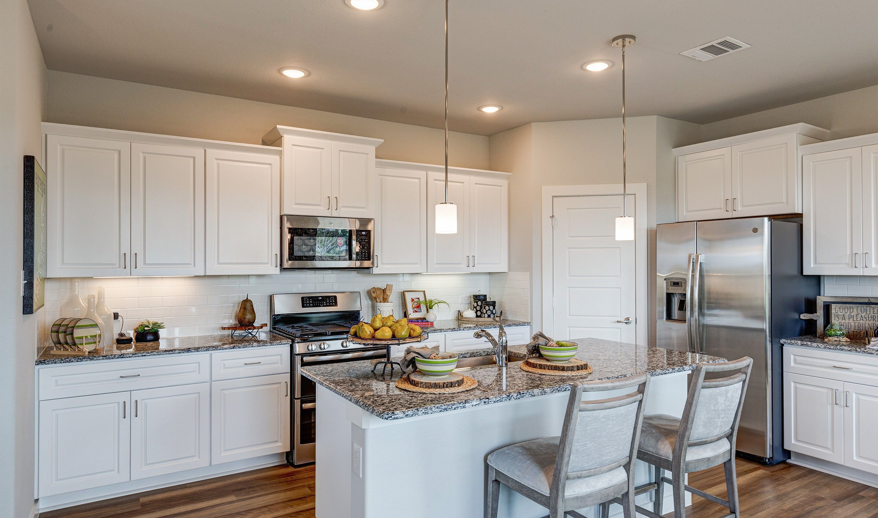 Kitchen featured in the Dover II - 3 Car By K. Hovnanian® Homes in Dallas, TX
