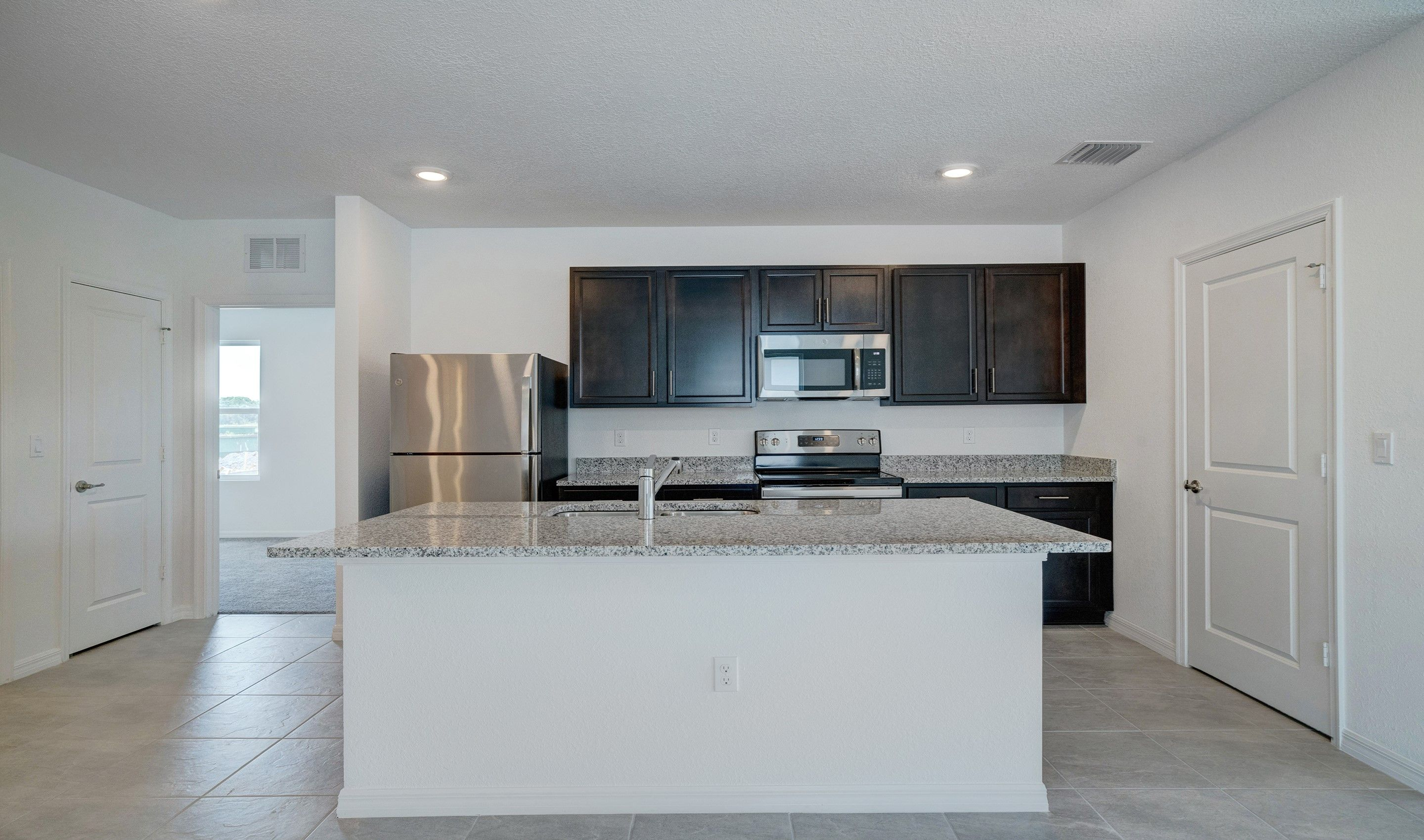 Kitchen featured in the Ashmere By K. Hovnanian® Homes in Tampa-St. Petersburg, FL