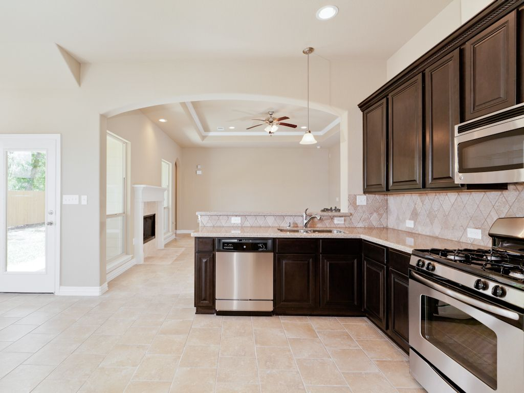 Kitchen featured in The Marie By Kinsmen Homes  in Beaumont, TX