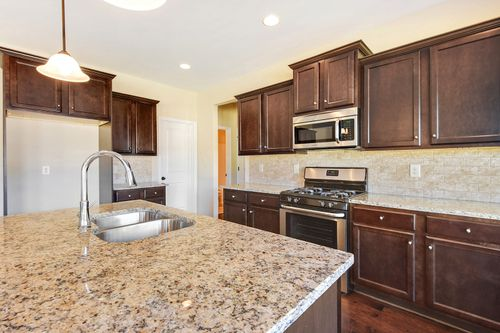 Kitchen-in-The Abigail I-at-Cambridge Meadows-in-Atlanta