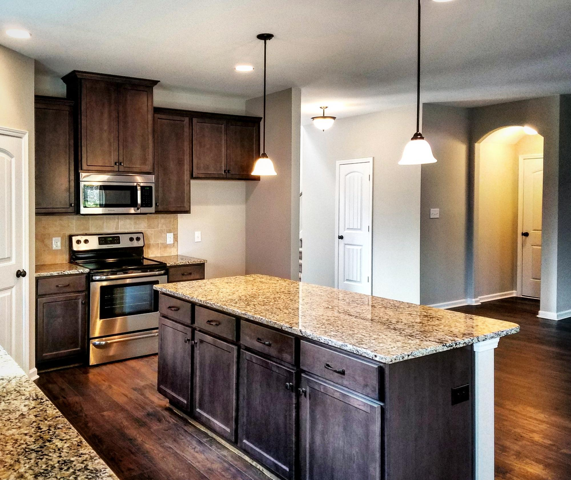 Kitchen featured in the Crawford By Konter Quality Homes in Savannah, GA