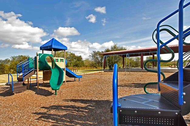 LGI Homes at Foster Meadows:Residents enjoy park amenities including a new children's playground!